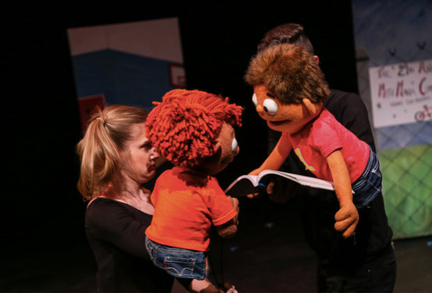 PHOTO: Live performance of Addy & Uno underway, with two characters represented as puppets onstage.
